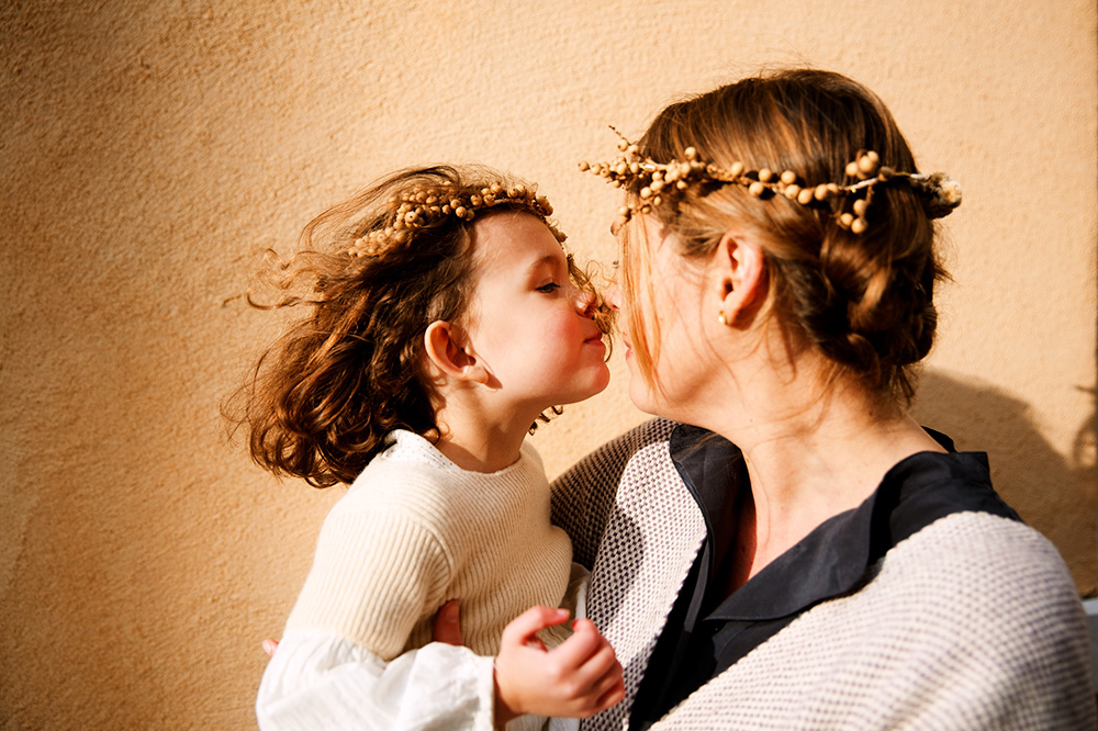Mother and child wearing Flowershop flower crowns, photo by Olivia Rae James
