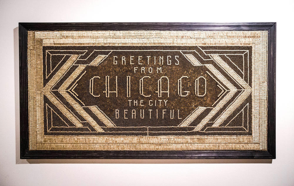 "Installation by Jenna Blazevich made of 27,000 .22 caliber bullet casings, spelling out ""Greetings from Chicago, the city beautiful"""