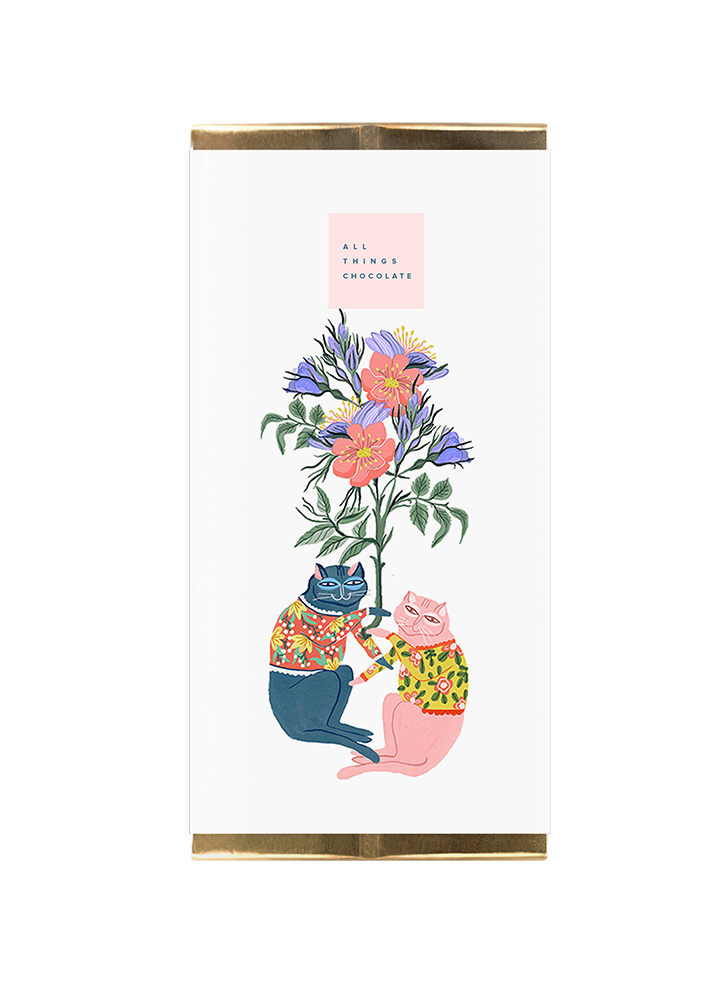 A chocolate bar called 'All things chocolate' with an illustration of two cats and a bunch of flowers by Manuja Waldia