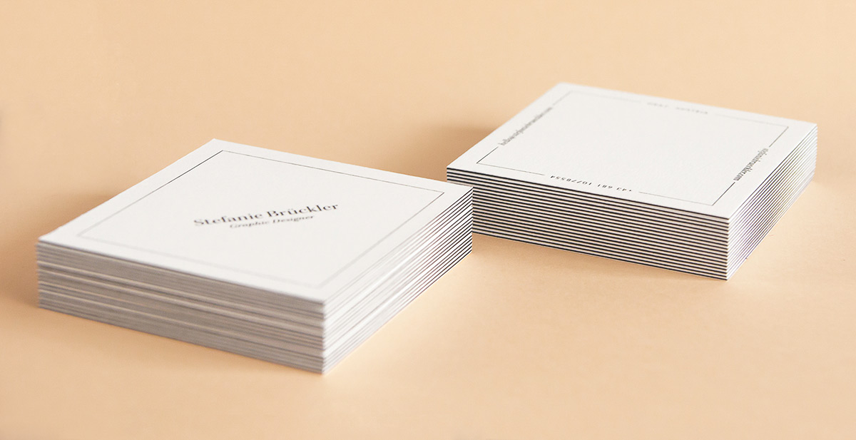Stacks of Stefanie Brückler's business cards, designed by Stefanie Brückler